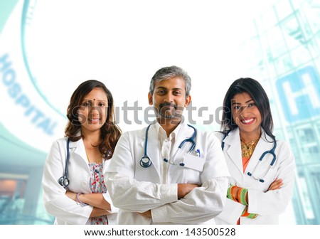 Indian doctors. Group of Indian medical doctors, male and female standing inside hospital.