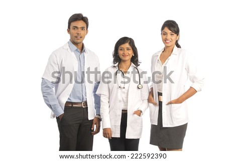 Indian doctors. Group of Indian medical doctors, male and female standing isolated on white background. - stock photo