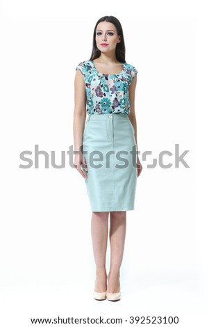 indian eastern brown hair business executive woman with straight hair style in blue skirt and printed summer blouse high heel shoes standing full body length isolated on white