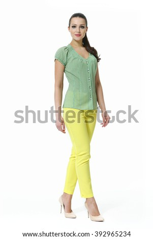 indian eastern brunette business executive woman with straight hair style in printed ethnic summer short sleeve blouse and yellow jeans high heel shoes standing full body length isolated on white - stock photo