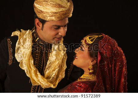 IndIan family bride and groom - stock photo