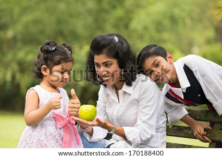 indian family outdoor eating healthy photo - stock photo