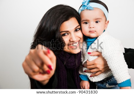 Indian family, portrait of happy Indian mother with little baby girl - stock photo