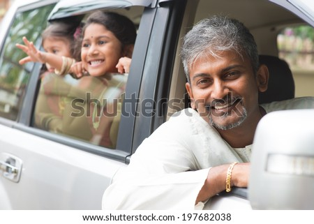 Indian family sitting in car ready to trip. Asian parent and children lifestyle.