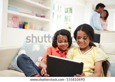 Indian Family With Digital Tablet At Home - stock photo