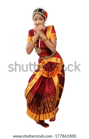 Indian female performing Bharathanatyam doing the action of  bhayanaka or fear - stock photo