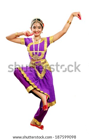 Indian female performing Bharathanatyam doing the action of  depicting Lord Ganesha  in violet color costumes  - stock photo