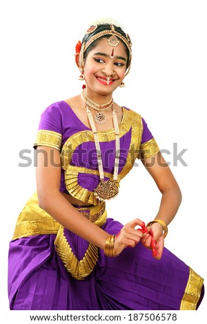 Indian female performing Bharathanatyam doing the action of  holding the symbols(tala)  in violet  color costumes. - stock photo