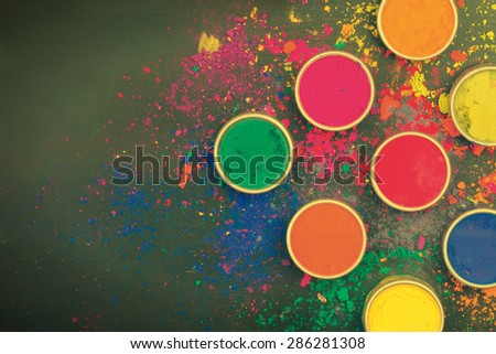 Indian festival colors on dark background - stock photo