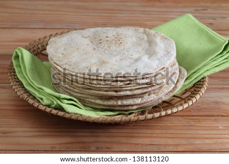 Indian flat-bread called chapati in basket - stock photo