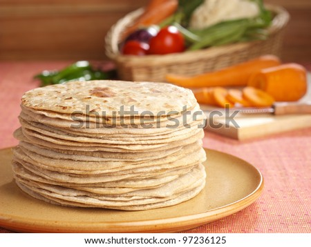 Indian flatbread called chapati  (Selective Focus, Focus on the front chapatis) - stock photo