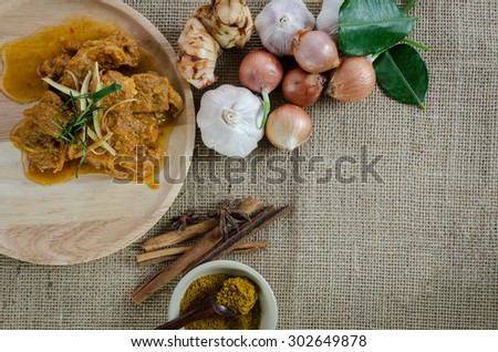 Indian food cooked with curry powder and herbs - stock photo