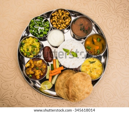 indian food platter, indian thali, indian veg thali,paratha, rice, aalu bhaji,puri or poori, complete meal, south indian thali