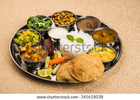 indian food platter, indian thali, indian veg thali,paratha, rice, aalu bhaji,puri or poori, complete meal, south indian thali - stock photo