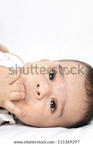 Indian Four-month old Baby Sucks on His Fingers