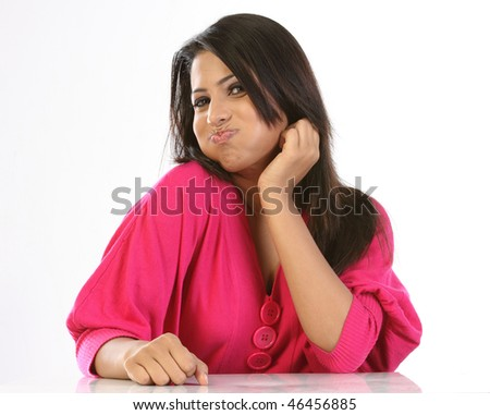 Indian girl doing oil pulling - stock photo