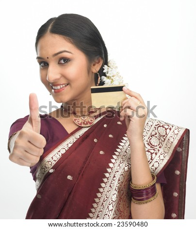 Indian girl in red silk sari with credit-card - stock photo