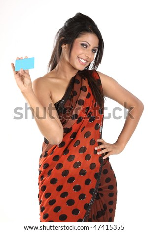 Indian girl in sari holding blue blank credit card - stock photo