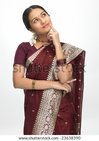 indian girl in silk sari with thinking expression - stock photo