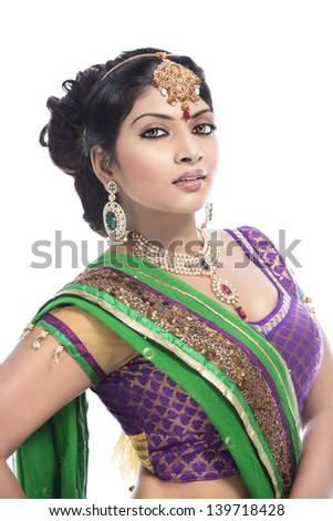 Indian girl in traditional Indian sari posing on white background ...