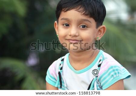 Indian Girl Looking at Camera - stock photo