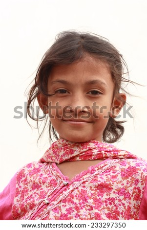 Indian girl looking at camera with sweet smile on her face - stock photo
