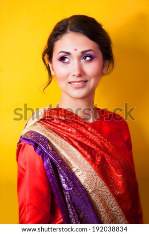 Indian girl on yellow background - stock photo
