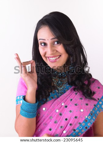 Indian girl saying excellent - stock photo