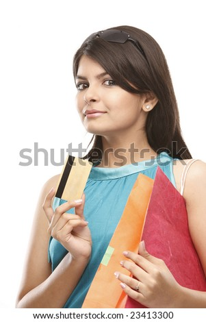 indian girl showing the credit card having the shopping bags