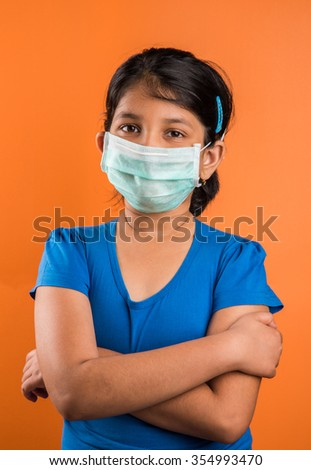 indian girl wearing face mask, Flu illness child girl in medicine healthcare mask, A Little indian girl with the protective mask, asian girl wearing medical mask, swine flu - stock photo