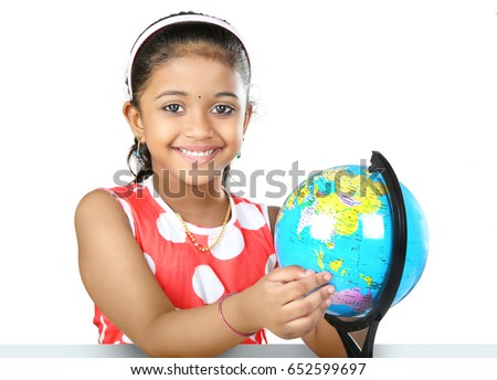 Indian girl with a globe in her study room.