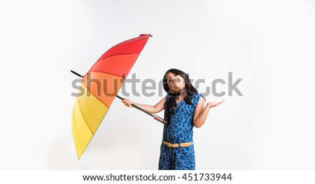 Indian Girl with big multicolored umbrella, isolated over white