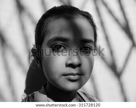 Indian girl with sunlight shadow