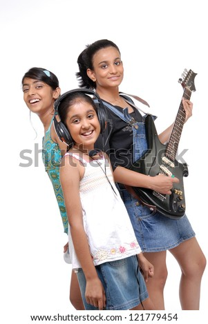 Indian girls music band over white background - stock photo