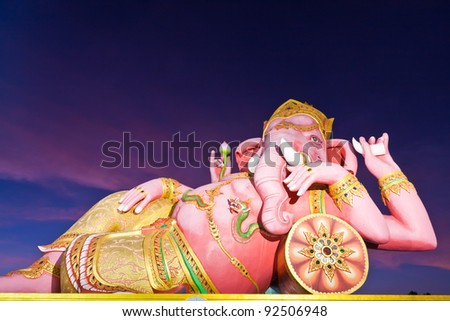 "Indian god ""Ganesha"" statue in twilight in Thailand"