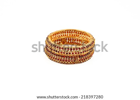 Indian Gold Bangles, isolated on white background. - stock photo