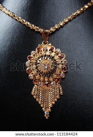 Indian Gold Necklace with gemstones - stock photo