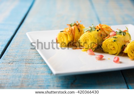 Indian gram flour snack snack called Khandvi or suralichya vadya, selective focus