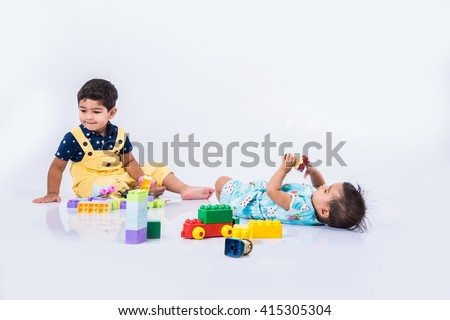 Indian kids playing with block toys - stock photo