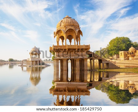 Indian landmarks - Gadi Sagar temple on Gadisar lake -  Jaisalmer, Rajasthan, north India - stock photo