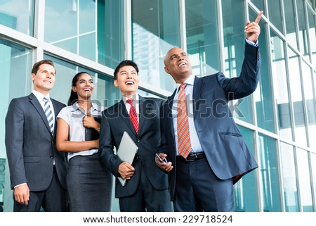 Indian Leader explaining his vision giving outlook to his business team in Asia - stock photo