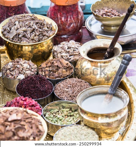 Indian Lifestyle scene. Roadside vendor and his elaborate preparation of ingredients used to prepare Paan.Betel leaves (Piper Betle). Betel leaves are mixed with ground nuts and optionally tobacco - stock photo