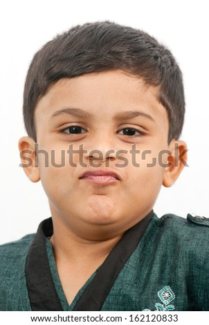 Indian little boy in funny mood on white background