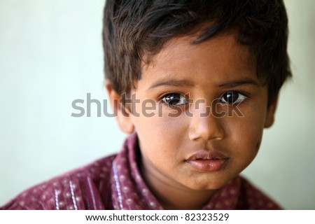 Indian little boy with expression in outdoor. - stock photo
