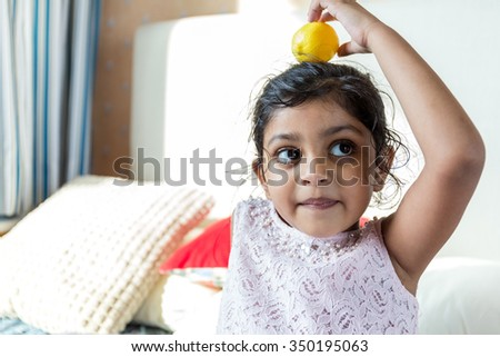 Indian little girl play with toy at home