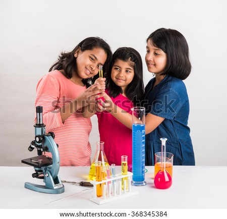 indian little girls or indian students and science experiments. Education. asian kids and science experiments, chemistry experiment, indian girls and science experiments  - stock photo