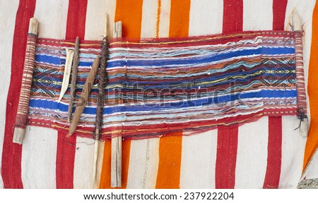 Indian loom in weaving process - stock photo