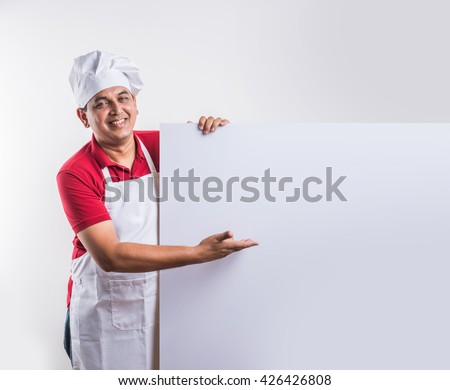 indian male Chef presenting a white board. Isolated on white background - stock photo