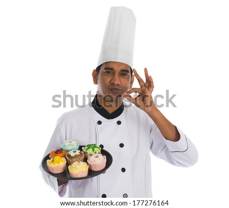 indian male chef with tasty ok sign and white background - stock photo