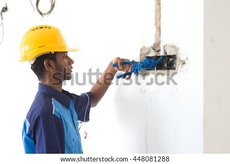 indian male electrical engineer doing works
